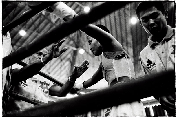 Samson�s trainer shouts advice between rounds. Her boxing prowess got her released early from prison.