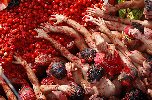 Revelers fight for tomatoes during the annual food fight, the Tomatina, in the town of Bunol, Spain, Wednesday, Aug. 27, 2008.