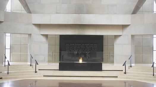 A small flame burns in front of a plaque at the Holocaust Memorial Museum in Washington, DC