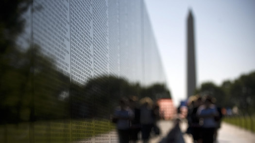 Visitors file by the Wall, which currently contains 58,249 names of fallen soldiers, while visiting the Vietnam Veterans Memorial in Washington, DC,