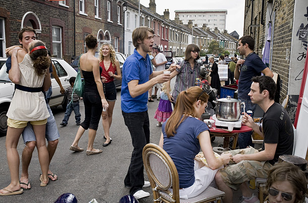 Neighbors gather for the second annual Belfast Road junk sale and street party in London's Stoke Newington