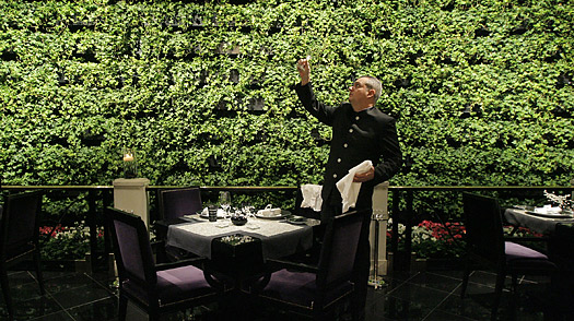 Chef de rang Yann Bousseau sets a table at Joel Robuchon, a Michelin three-star restaurant, at the MGM Grand hotel and casino in, Las Vegas, NV.