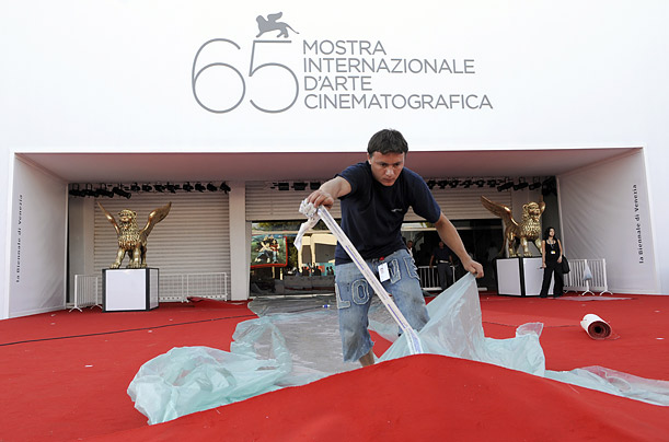 A worker prepares the red carpet at the entrance of the cinema palace on the eve the 65th Venice Film Festival at Venice Lido on August 26, 2008.