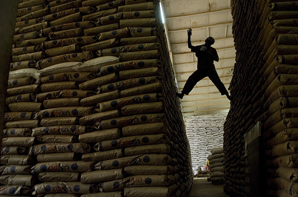 Grain bought in Uganda or donated by Western nations awaits distribution in piles as high as a three storey house