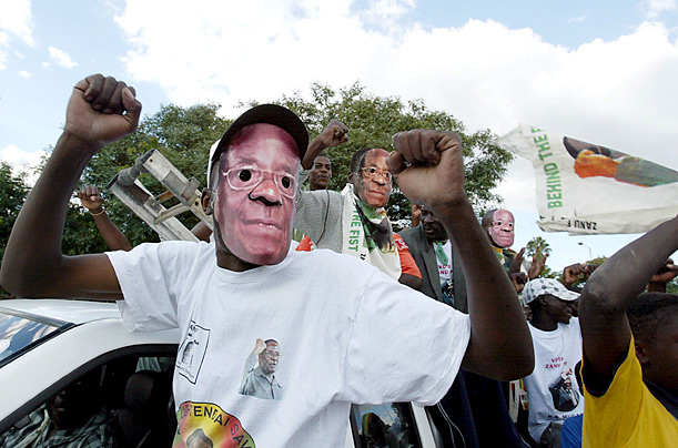 Supporters of President Robert Mugabe wear face masks the day before the presidential elections, Harare, Zimbabwe, 28 March 2008.