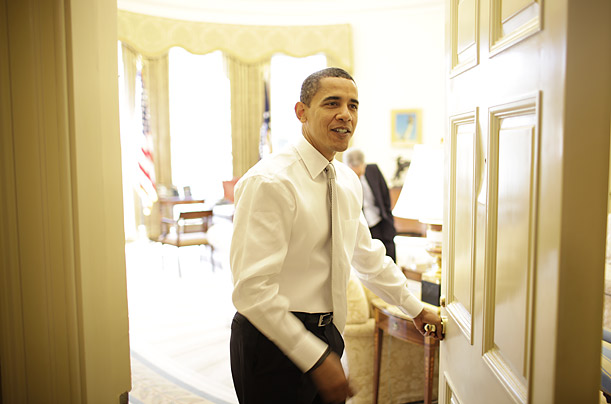The President opens the door to the Oval Office for visitors.