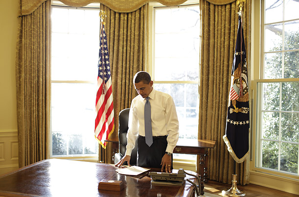 The President stands behind his desk on January 21.