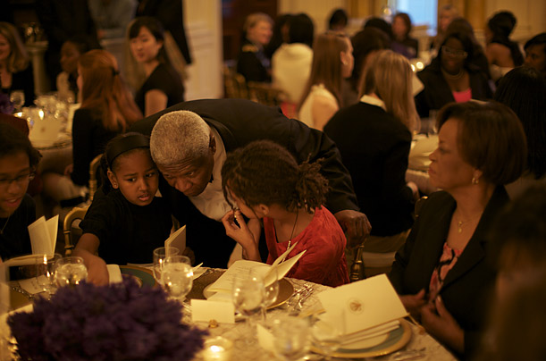 White House butler James Ramsey speaks with Malia and Sasha during a dinner organized at the White House by Michelle Obama for public high school students.