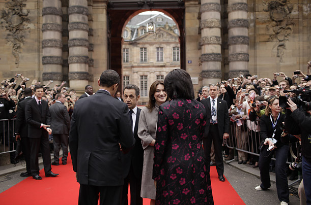 French President Nicolas Sarkozy and his wife Carla Bruni greet Barack and Michelle upon their arrival at the Palais Rohan in Strasbourg.