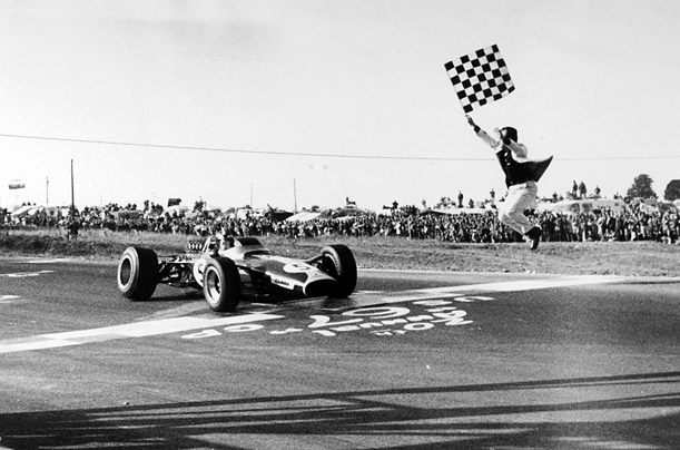 Great Britain's Jim Clark takes the trophy at the American Grand Prix in 1967