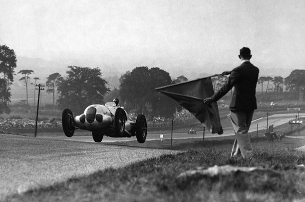 Germany's Bernd Rosemeyer takes the chequered flag at Donnington Park in England, 1937