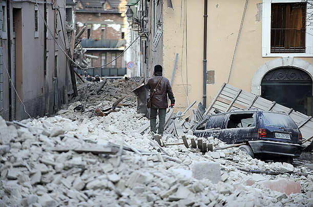 Rubble from collapsed buildings fills the streets at the epicentre of the quake which measured 5.8 on the Richter scale