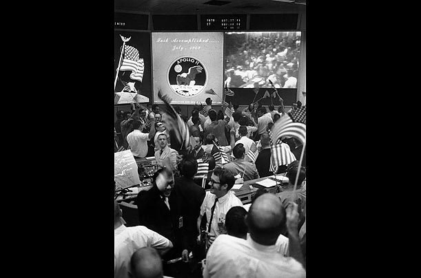 Technicians at Mission Control in Houston celebrate the splashdown on July 24, 1969.