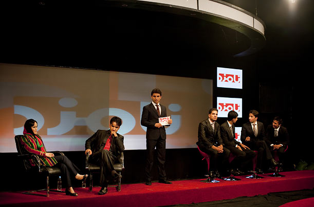 <span style='font-style: italic'>The Candidate</span> films an episode with the final contestants, Ajuba Dadqiq, 19, left, and Muneer Farahmand, 20.