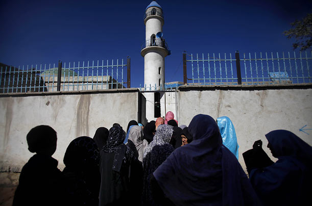 Afghan women line up to cast their ballots at a Kabul mosque in what is widely considered a critical step not only for the country but also