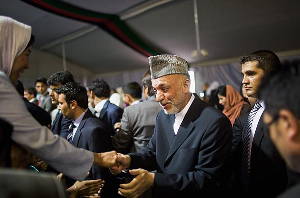 Afghan president Hamid Karzai meets with supporters at an election campaign rally for women teachers in Kabul.