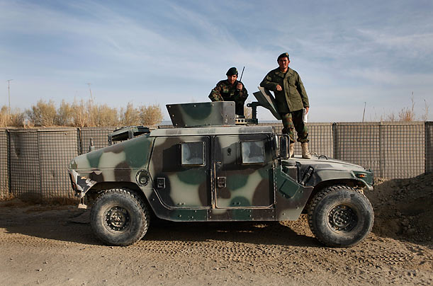 Vehicle  Soldiers with the Afghan National Army pose with a humvee on a base near Sharan, Afghanistan.