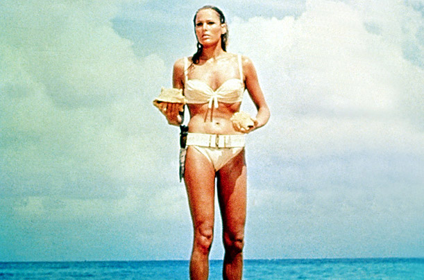 Ursula Andress, playing Honey Rider, in the first Bond film Dr. No, strides out of  tropical Caribbean waters in her home made bikini
