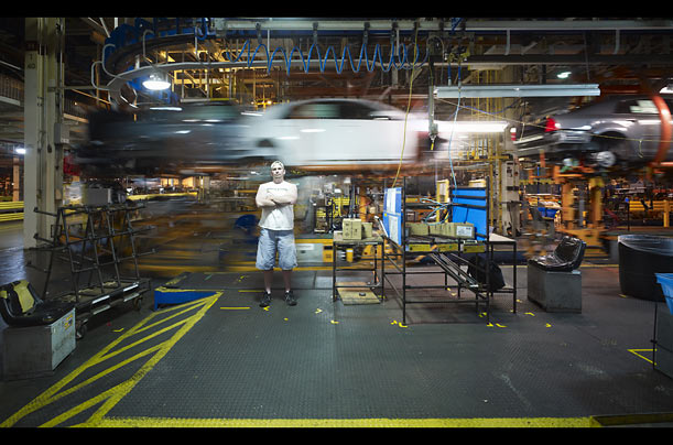 Autoworker Mason Hurley stands beside the line at GM's Fairfax Assembly Plant in Kansas City, Kans.