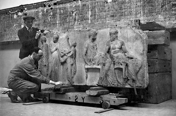 The Elgin Marbles, sculptured stones carved centuries ago and forming part of the frieze of the famous Parthenon in Athens, are brought from their war-time home in a London Underground Railway tunnel, back to the museum in London