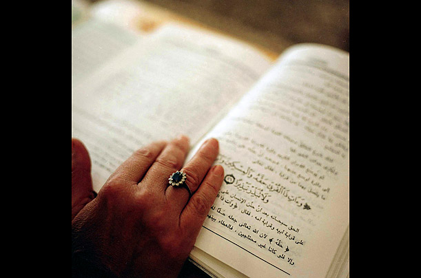 A woman reads a Koran in Cairo.