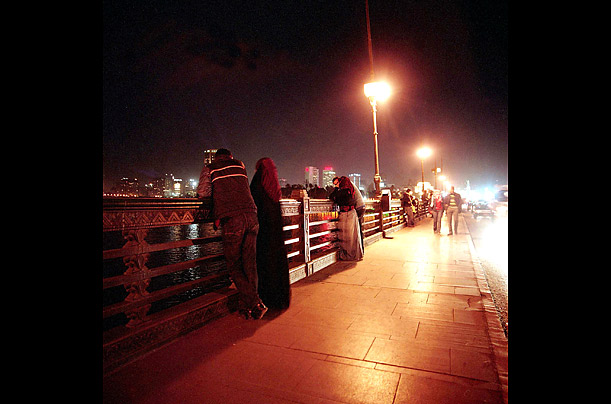 Couples gather in the evening on Cairo's Qasr el-Nil Bridge.