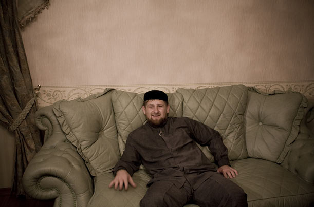 The Chechen President lounges on a couch in his village residence.