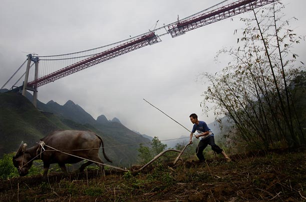 The 1.4-mile Bailing River Bridge in Guizhou is one of hundreds of infrastructure projects initiated by the Chinese as a way to create jobs and improve its domestic economy.