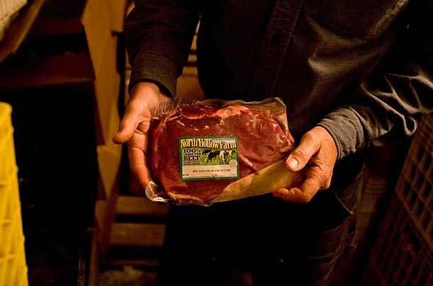 <span style='font-weight: bold'>Value</span><br />Mike Bowen, the owner of North Hollow Farms shows off a sirloin steak. The beef produced by cow-pooling ends up costing $3 to $5 a pound.