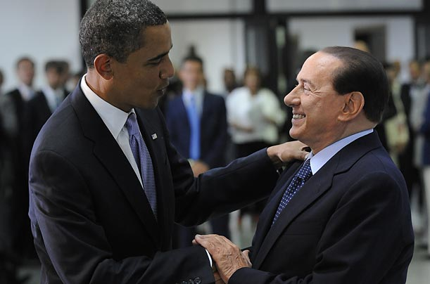 G8 host, Italian Prime Minister Silvio Berlusconi greets U.S. President Barack Obama on the first day of the three-day conference.