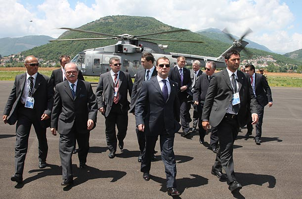 Russian President Dmitri Medvedev and his team arrive at the summit, held in L'Aquila.