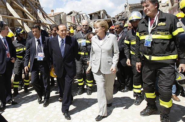Areas near L'Aquila, the town where the summit is taking place, were hit by a brutal earthquake in April 2009. In this photo, Berlusconi gives German Chancellor Angela Merkel a tour of the ruined city of Onna.