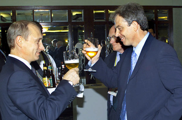 Russian President Vladimir Putin and British PM Tony Blair toast each other in 2002 in Kananaskis, Canada.