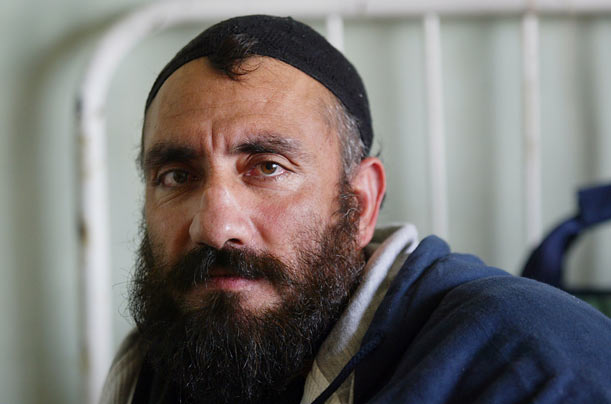 One of the first to be released in 2002, Mohammad, a farmer, says that he was forcibly conscripted into the Taliban, but tried to