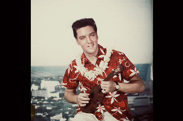 An Alfred Shaheen-designed red aloha shirt was deemed cool enough for Elvis on the cover of his 1961 <em>Blue Hawaii</em> soundtrack