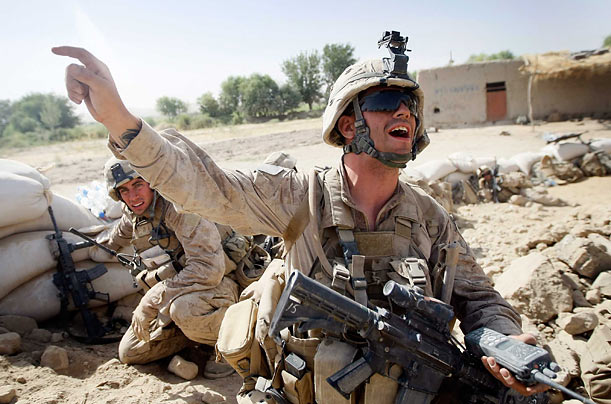 Marines react to enemy fire on July 4, in Mian Poshteh, Afghanistan. The soldiers are part of Operation Khanjari, which was launched