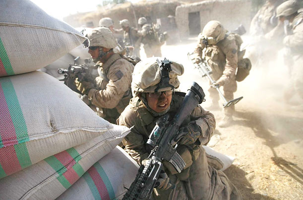 Marines take cover during a firefight in Mian Poshteh.