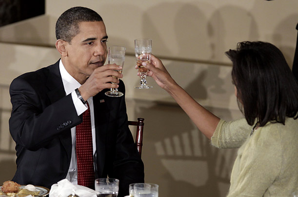 President Obama toasts with his wife Michelle at the Inaugural Luncheon
