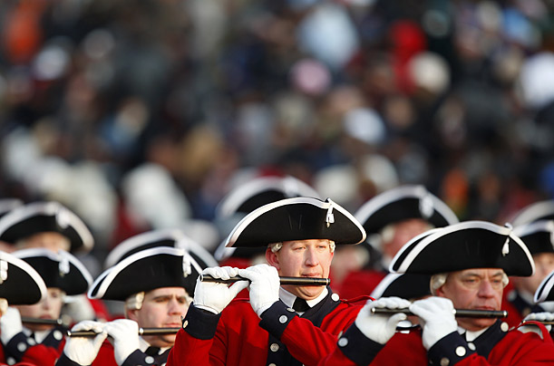 A marching band walks down Pennsylvania Avenue during the Inauguration parade