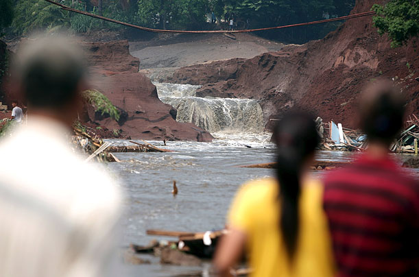 The dam burst after hours of rain