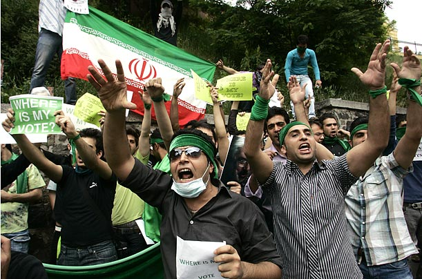 Outside the Iranian embassy in Kiev, Iranian students hold a demonstration against the election results.