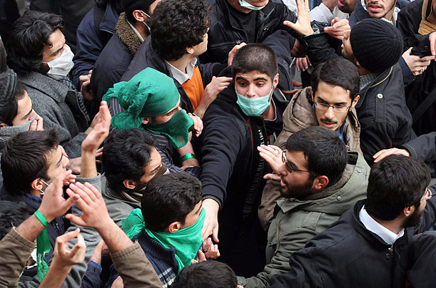 Pro-reform students clash with hard-liners in central Tehran. Witnesses have reported that 2,000 pro-government Basiji students were brought into Tehran University to counter the protests.