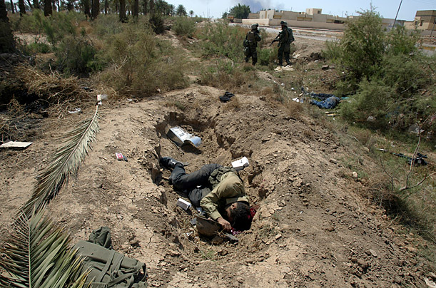 An Iraqi solider lies dead in a hole after attempting to ambush a U.S. tank column.