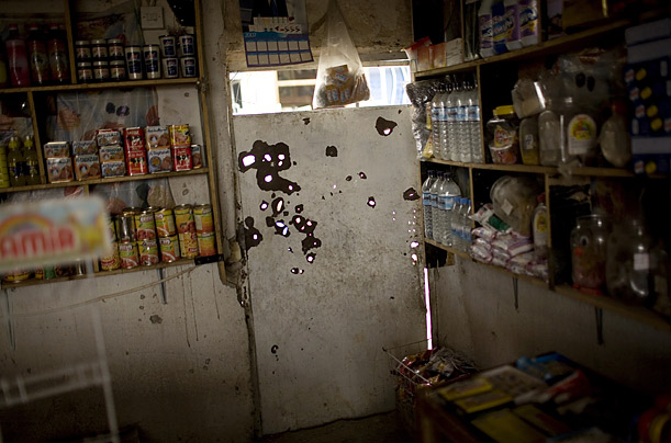 Bullet holes mark a door of a small shop in Sadr City, the fiefdom of the Madhi Army militia, loyal to Shi'ite cleric Muqtada al-Sadr.