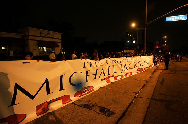 Michael jackson fans hold a large sign on Glendale Blvd