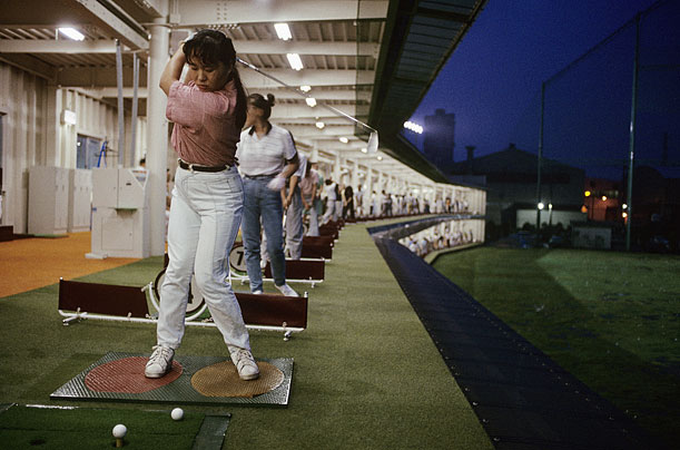 A woman practices her iron shots at a females-only driving range in Tokyo in August 1989