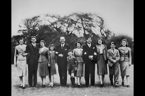 Joseph Kennedy Sr. (fifth from left) and his wife Rose (fifth from right) pose for a family portrait on the grounds of the U.S. embassy in London, where Joe was serving as U.S. ambassador to the U.K.