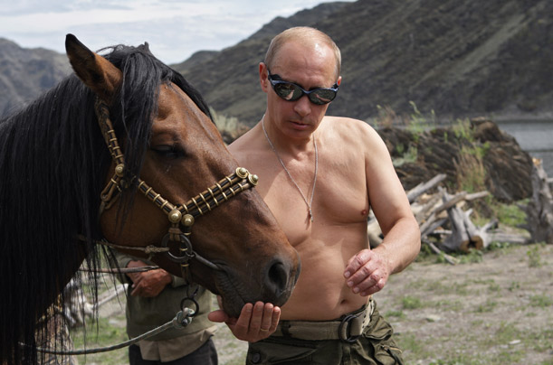 Russian Prime Minister Vladimir Putin feeds a horse during his vacation in the Republic of Tyva, Russia, on Aug. 3, 2009