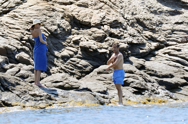 French President Nicolas Sarkozy and his eife Carla Bruni-Sarkozy during their holidays at Cap Negre