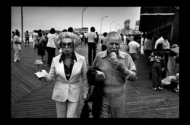 An elderly couple eating ice cream